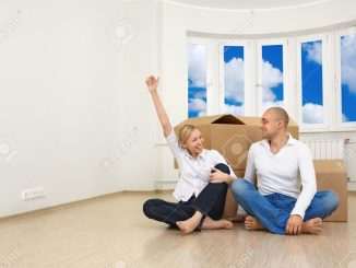 4488067-A-man-and-a-woman-are-happy-with-their-new-flat-Stock-Photo